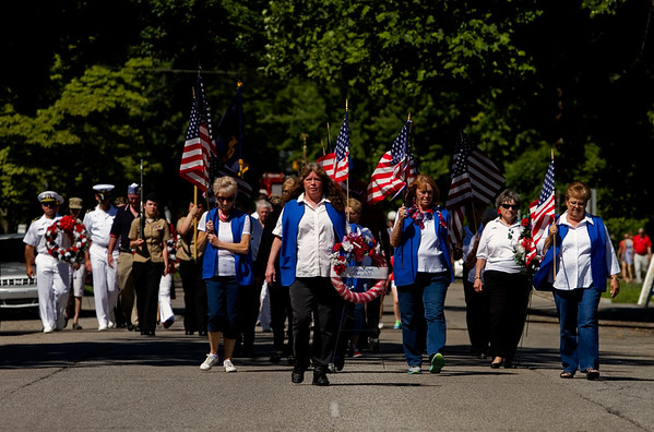Members of the Veterans of Foreign Wars Post 1693 Auxillary lead a procession along Market Street on their way to the annual Memorial Day program at Veterans' Plaza in New Albany on Monday morning. Staff photo by Christopher Fryer