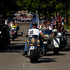 Motorcyclists move along Market Street on their way to the annual Memorial Day program at Veterans' Plaza in New Albany on Monday morning. Staff photo by Christopher Fryer