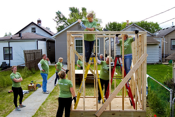 A team of volunteers from Schuler Bauer Real Estate Services, 4206 Charlestown Rd., work to build a shed behind the home located at 2231 McLean Ave. in New Albany as part of Habitat for Humanity's National Women Build Week on Tuesday. Staff photo by Christopher Fryer