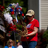 Marti Snyder, with the Floyd County Veterans Service Office, lays a wreath for the organization during the annual Memorial Day program at Veterans' Plaza in New Albany on Monday morning. Staff photo by Christopher Fryer
