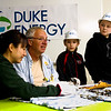 Mt. Tabor Elementary School third-graders Mason Vittitow, 9, far right, and Olivia Saydera, 8, center right, look on as John Castrale, a retired Indiana Department of Natural Resources nongame bird biologist, center left, and Allisyn-Marie Gillet, Castrale's successor with the Ind. DNR, examine and tag a peregrine falcon chick at Duke Energy's Gallagher Generating Station in New Albany on Monday morning. Staff photo by Christopher Fryer