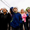 Mt. Tabor Elementary School students look on as bird biologists with the Indiana Department of Natural Resources retrieve three peregrine falcon chicks from their nest located about 400 feet up on one of the two stacks at Duke Energy's Gallagher Generating Station in New Albany on Monday. Staff photo by Christopher Fryer