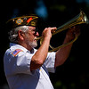 Eddie Chambers, with Veterans of Foreign Wars Post 1693, plays taps during the annual Memorial Day program at Veterans' Plaza in New Albany on Monday morning. Staff photo by Christopher Fryer