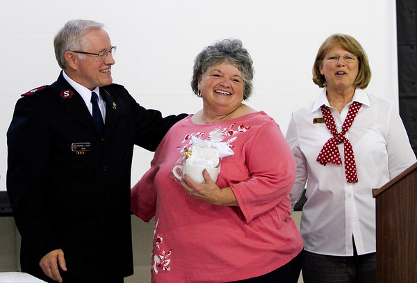 Denise McCormick, Georgetown, center is recognized for her volunteer work during the Salvation Army of Southern Indiana's annual volunteer appreciation luncheon in New Albany on Wednesday. Staff photo by Christopher Fryer