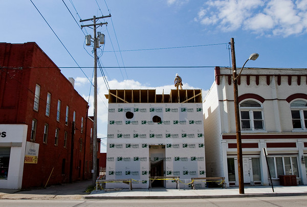 The facade of the new building being constructed at 121 E. Spring St. is pictured in downtown New Albany on Thursday afternoon. The structure is expected to be completed by this fall, and it will house the offices of T.J. Boofter Land Surveyor and Civil Engineer. Staff photo by Christopher Fryer