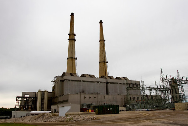 The two stacks at Duke Energy's Gallagher Generating Station are pictured in New Albany on Monday morning. The Indiana Department of Natural Resources maintains a peregrine falcon nest about 400 feet up on the left stack, and bird biologists rwith the department etrieved three chicks from the nest to examine and tag them for cataloging purposes. Staff photo by Christopher Fryer