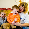 (Left to right) Liam Auld, 3, and his brother Kia Auld, 2, clown around with their grandmother, Leanne McNamee in their apartment in Jeffersonville. Staff Photo By Josh Hicks