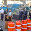 Kentucky, Indiana and bridge officials celebrate the completion of the downtown crossing underneath the Lincoln bridge in Louisville on Friday. Staff Photo By Josh Hicks