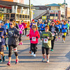 Runners take on the first leg during D*A*S*H, the 5K veteran tribute on the riverfront in Jeffersonville on Saturday. Staff Photo By Josh Hicks
