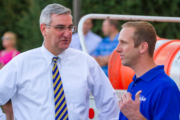 Governor-elect Eric Holcomb speaks with the construction manager of Walsh Construction Nick Fall in Louisville on Friday. Staff Photo By Josh Hicks