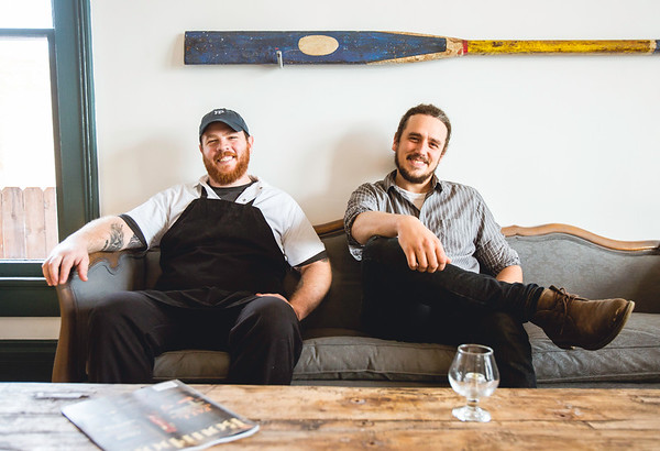 Chef Paul Skulas, left, and Bar Manager Dan Mahony pose in the lounge area of the Portage House on Thursday. The Portage House is located at 117 East Riverside Drive in Jeffersonville. Staff Photo By Josh Hicks