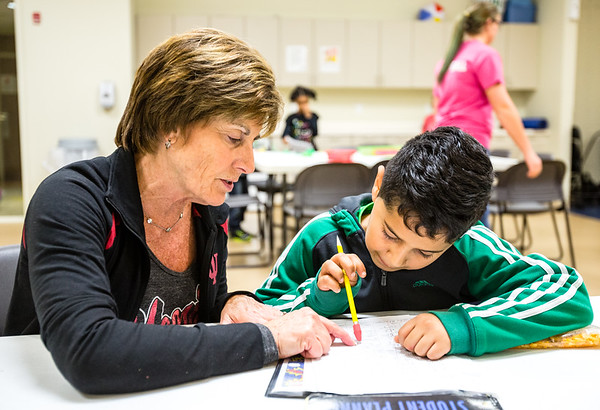 Sue Rainbolt, left, a retired teacher of 33 years, helps Clarksville Elementary School student Alex Burnett, 8, with some math homework at the Clark County YMCA on Wednesday. Staff Photo By Josh Hicks