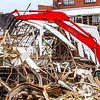 An excavator demolishes a building at the old Charlestown Powder Plant. Staff Photo By Josh Hicks