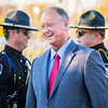 Mayor Mike Moore shares a laugh with members of the Jeffersonville Police Department before delivering a speech accepting Big Four Station's new American Flag on Thursday. Staff Photo By Josh Hicks