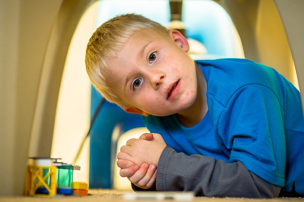 "Aiden Bechtel, 6, takes a break from building what he called a ""tower"" of blocks to look into the camera. Staff Photo By Josh Hicks"