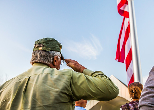 Steve Voelker, of the First Cavalry Division that toured Vietnam, salutes the new American Flag at Big Four Station in Jeffersonville on Thursday. Staff Photo By Josh Hicks