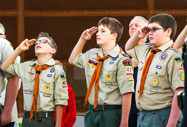 Boy Scouts of Jeffersonville Troop #43 [left to right] Ryan Hays, 13, Austin Ruetten, 12, and Thomas Haub, 13, saulte the Big Four Station's American Flag while reciting The Pledge of Allegiance on Thursday. Staff Photo By Josh Hicks