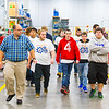 Students from Jeffersonville High School tour the Amatrol facility in Jeffersonville on Wednesday for National Manufacturing Day. Staff Photo By Josh HIcks