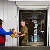 UPS employees load a truck at a new mobile distribution center in Clarksville. The facility, which will open mid-November, aims to help UPS make timely deliveries as they experience the holiday surge in package volume. Staff Photo By Josh Hicks