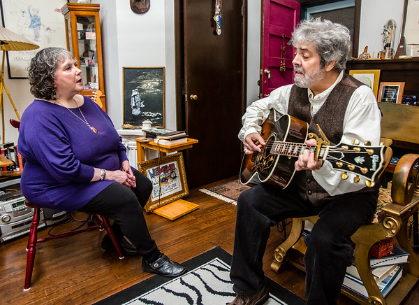 "Pam Bustch, left, and her husband Rick Bustch perform ""Exit Zero,"" an original song featured on their album from which proceeds are being donated to Jeffersonville's non-profit organization Exit 0. Staff Photo By Josh Hicks"