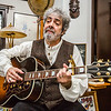 "Rick Butsch performs ""The Song of Wandering Aengus,"" written by William Butler Yeats, set to his own music at his home studio in Jeffersonville. Butsch first picked up a guitar around the age of 14 and is pictured with his Gibson Songwriter, one of the world's most famous guitars. Through its vintage fretboard, he keeps his 1960's influences alive. Staff Photo By Josh Hicks"