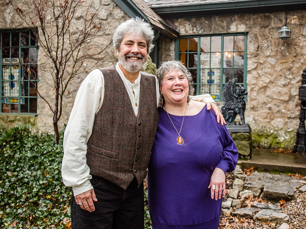 Rick Butsch, left, and his wife Pam Butsch smile in front of their home in Jeffersonville. Rick created a painting of their house and used it as artwork for their 11 track album. Staff Photo By Josh Hicks