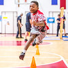 Fourth grader Romello Blincoe leaps over cones  during a fire safety and prevention obstacle course set up in Clarksville Elementary gym on Thursday. Staff Photo By Josh Hicks
