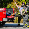 """An animal rights activist shouts, """"save the animals,"""" as he's loaded into a pick up truck during a training exercise at The Louisville and Indiana Railroad in Jeffersonville on Tuesday. Staff Photo By Josh Hicks"""