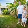 David and Ellen Keith show off their elephant ear plants in the backyard of their home in the Pleasant Ridge neighborhood in Charlestown. The two have lived there for forty years, since they were married. Staff Photo By Josh Hicks