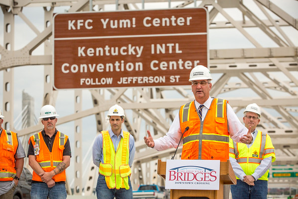 Indiana Lt. Govenor Eric Holcomb announces that drivers on I-65 south will have direct access to I-64 east, I-64 west and I-71 north from the John F. Kennedy Memorial Bridge starting early Oct. 10. Staff Photo By Josh Hicks