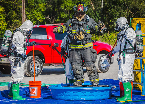 After investigating The Safety Train's mock incident, a first responding firefighter gets scrubbed down by a hazmat team at The Louisville and Indiana Railroad in Jeffersonville on Tuesday. Staff Photo By Josh Hicks