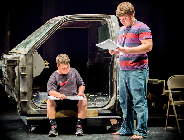 """Charlestown Middle School's Dallas Edwards, 12, going over some lines with director Kyle Reagan during Charlestown High School's rehearsal for Queen musical """"We Will Rock You."""" Staff Photo By Josh Hicks"""