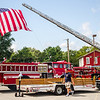 Firefighter Matt Bowyer, packing up after the Vintage Fire Museum's 9/11 Memorial Service in Jeffersonville on Saturday. Photos courtsey of Ray Parriella Staff Photo By Josh Hicks
