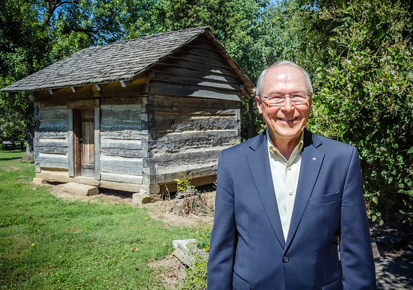 Jim Keith stands in front of one of the cabins at the George Rogers Clark homesite in New Albany on Tuesday.  The three day Lewis & Clark Indiana Bicentennial Festival Celebration will be located at the homesite at 1102 W. Harrison Ave., from 10 a.m. to 4 p.m., beginning on Friday, September 30.
