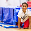 Fourth grader Ray'von Farley emerges from a tunnel during a fire safety and prevention obstacle course set up in Clarksville Elementary gym on Thursday. Staff Photo By Josh Hicks