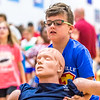 Fourth grader Remy Schwartz saving a dummy during a fire safety and prevention obstacle course set up in Clarksville Elementary gym on Thursday. Staff Photo By Josh Hicks