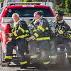 Figherfighters rush to get cleaned by a hazmat team during a training exercise at The Louisville and Indiana Railroad in Jeffersonville on Tuesday. Staff Photo By Josh Hicks