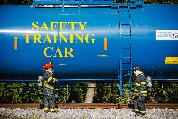 Local, first responding firefighters assess an issue during a training exercise at The Louisville and Indiana Railroad in Jeffersonville on Tuesday. Staff Photo By Josh Hicks