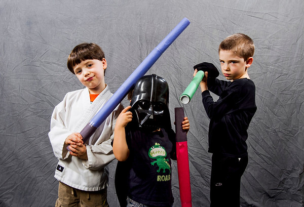 Brothers Desmond, 6, Arthur, 3, and Jonas Jentsch, 8, all of New Albany, pose for a portrait in their Star Wars costumes during Star Wars Day at the New Albany-Floyd County Public Library in downtown New Albany on Saturday afternoon. Staff photo by Christopher Fryer