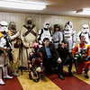 "David West Reynolds, center, the New Albany-based author of the series ""Star Wars: The Complete Visual Dictionary,"" poses for photographs with members of a local Star Wars costume group before giving a presentation during Star Wars Day at the New Albany-Floyd County Public Library in downtown New Albany on Saturday afternoon. Staff photo by Christopher Fryer"
