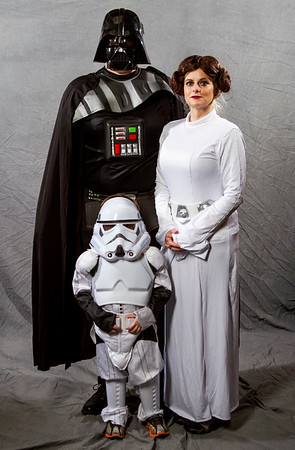 Sellersburg residents Jim and Wendi Merkle pose for a portrait with their son Colton, 4, during Star Wars Day at the New Albany-Floyd County Public Library in downtown New Albany on Saturday afternoon. Staff photo by Christopher Fryer