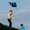 Ethen Kelich, 8, North Webster, flies a kite on the Jeffersonville riverfront during Thunder Over Louisville festivities Saturday. Staff photo by Christopher Fryer