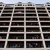 Spectators are pictured at the Harbors Condominiums during Thunder Over Louisville festivities Saturday. Staff photo by Christopher Fryer