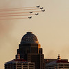 Aircraft participating in the Missing Man Tribute portion of the Thunder Over Louisville airshow are pictured above downtown Louisville on Saturday. Staff photo by Christopher Fryer