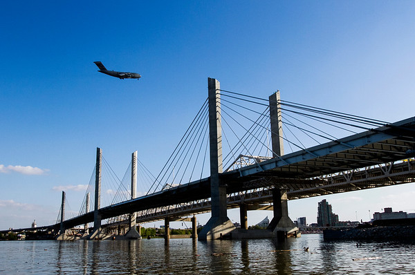 A Boeing C-17 soars above the Abraham Lincoln Bridge during Thunder Over Louisville on Saturday. Staff photo by Christopher Fryer