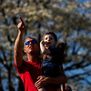 Mark Nanney, Jeffersonville, holds his grandson, Jonah, 2, Columbia City, as they watch aircraft soar above the Ohio River during Thunder Over Louisville on Saturday. Staff photo by Christopher Fryer