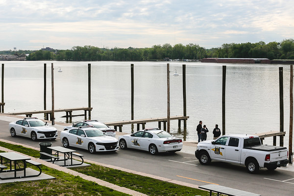 State Police vehicles line the Jeffersonville docks ahead of Tuesday's recovery operation of on Tuesday. Staff Photo By Josh Hicks