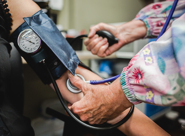 A nurse demonstrates how blood pressure is taken at Turning Point Center in Jeffersonville. Staff Photo Illustration by Josh Hicks