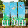 Kathy Haley donated this panel painting to the Joshua R. Rodriquez Community Garden. Staff Photo By Josh Hicks