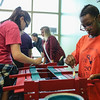 Freshman Leya Masterson, left, and junior Jadya Bellamy paint a wagon for Norton Children's Hospital at the Renaissance Acadmey in Clarksville on Friday. Staff Photo By Josh Hicks